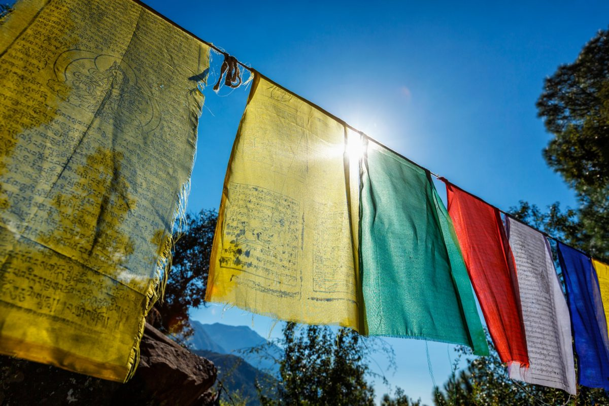 Prayer flags of Tibetan Buddhism with Buddhist mantra on it in Dharamshala monastery temple. India